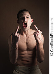 muscular guy without a shirt - A portrait of a hot guy man...