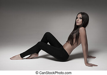 Sexy brunette woman wearing black leggings - Gorgeous young...