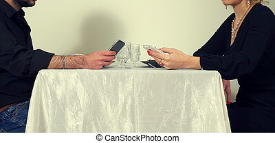 men and woman playing with phones
