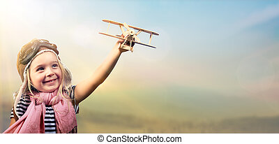 Freedom To Dream - Joyful Child Playing With Airplane...