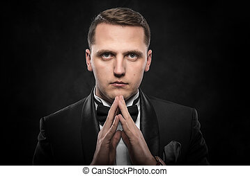 Portrait of businessman praying or thinking - Portrait of...