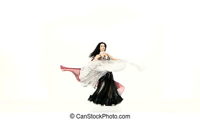 Beautiful exotic belly dancer with two wings, in unusual suit dance, on white, slow motion