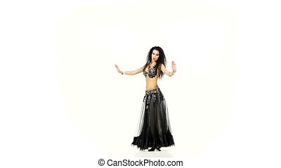 Beautiful exotic belly dancer shaking her hips, on white, slow motion