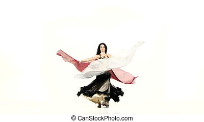 Young exotic belly dancer with two wings, in unusual suit dance, on white, slow motion
