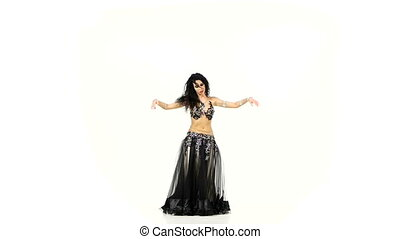 Young exotic belly dancer shaking her hips, on white, slow...