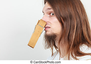 Man with clothespin on nose