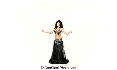 Beautiful belly dancer with dark hair in exotic suit...