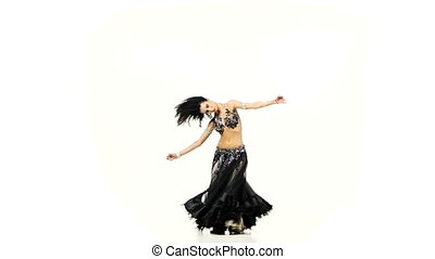 Belly dancer woman in dark and beige costume dance and...