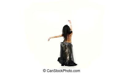 Exotic beautiful belly dancer with long dark hair shaking...