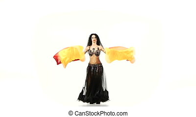 Belly dancer brunette woman dance with long fans, shaking...