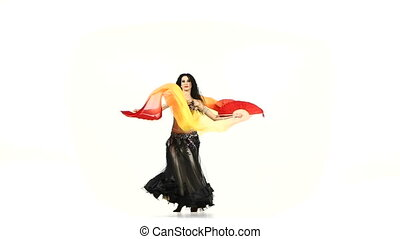 Belly dancer brunette girl in unusual costume dance with fans, whirls, on white, slow motion