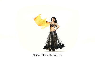 Talanted belly dancer girl dance with long fans, shaking her...