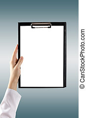 Female doctor's hand holding medical clipboard with blank...