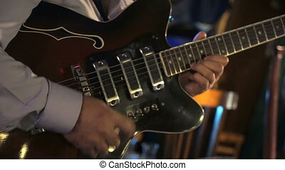 Guitar adjusts the electric guitar at the club