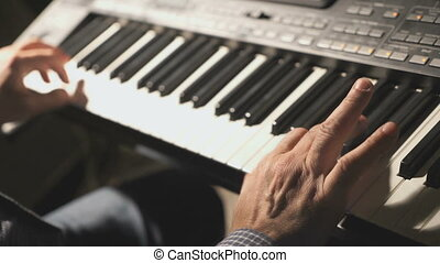 Man playing the synthesizer at the concert - Stylish man...
