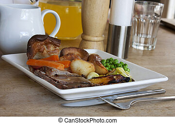 roast dinner on an old wooden table with background