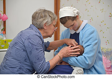 midwife with baby - A senior midwife checks a newborn baby...