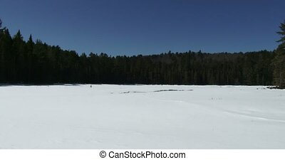 Panoramic view of frozen lake in winter in Algonquin...