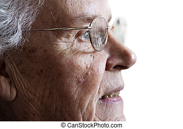elderly lady in 70\'s viewed from side on smiling