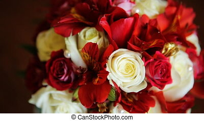 1. Amazing bouquet of incredible beauty made of pink, red and white roses  isolated on brown background.