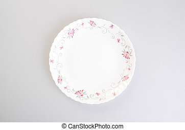 plate or china ceramic plate on a background. - plate or...