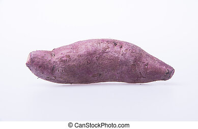 sweet potato or fresh purple yams on background - sweet...