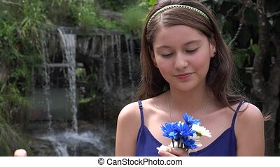 Pretty Teen Girl With Flowers