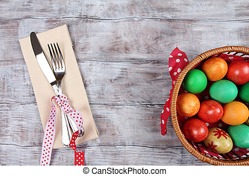 Basket with Easter eggs and cutlery