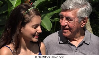 Teen Girl And Grandfather