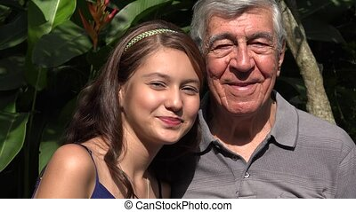 Teen Girl Smiling With Grandfather