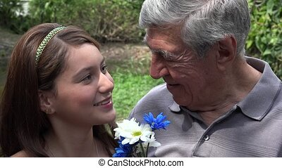Teen Girl And Grandfather Smiling