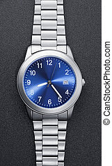 Stainless steel watch on black