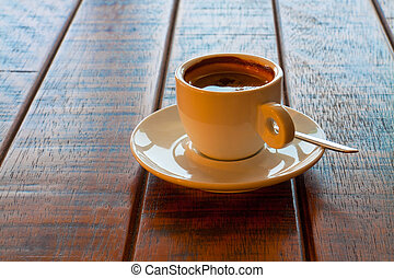Cup of coffee on wooden table - Cup of coffee on wooden...