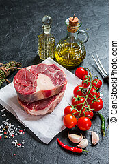 Raw veal shank slices meat and ingredients for Osso Buco...