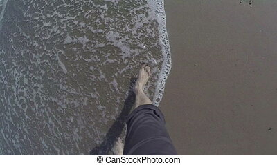 Bare feet are on the beach - Bare feet are on the sandy...