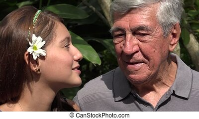 Teen Girl Talking To Grandfather