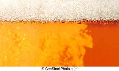 Beer is poured in a glass Closeup Slow motion - Beer is...