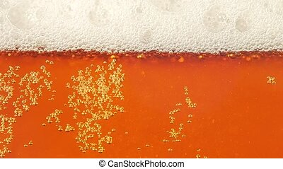 Glass full of beer moving bubbles. Slow motion. Closeup -...
