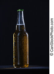 Bottle with beer on black background