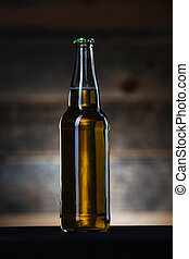 Bottle with beer on dark background