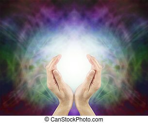 Pranic Healing Energy - Female hands cupped around a ball of...