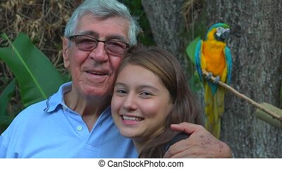 Grandfather Posing With Teen Girl