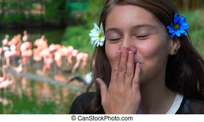 Pretty Teen Girl Blows Kiss