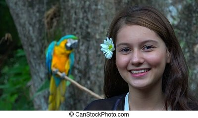 Smiling Teen Girl And Parrot