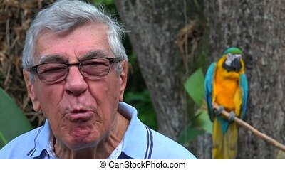 Silly Senior Man With Parrot