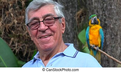Senior Man Smiling With Parrot