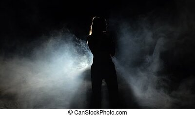 Girl athlete shows power karate moves. Black. Silhouette....
