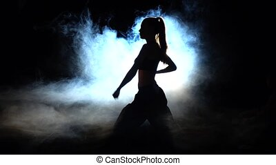 Vigorous training karate. Black. Silhouette. Backlight -...