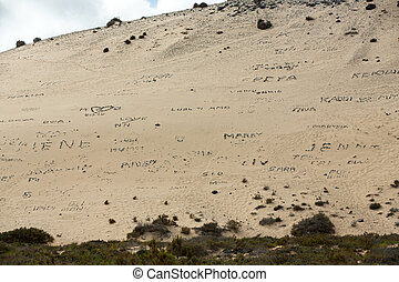 Inscriptions from stones on the beach Playa de Sotavento,...
