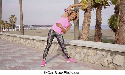 Trendy young woman doing aerobics exercises - Trendy slender...